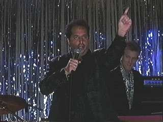 John Sawoski playing with Jon Lovitz in The Wedding Singer