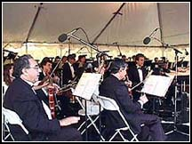 John Sawoski (directly below microphone on right) plays keyboard with Capistrano Valley Symphony